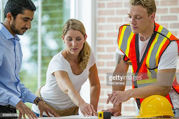 Architect Working with Construction Workers
