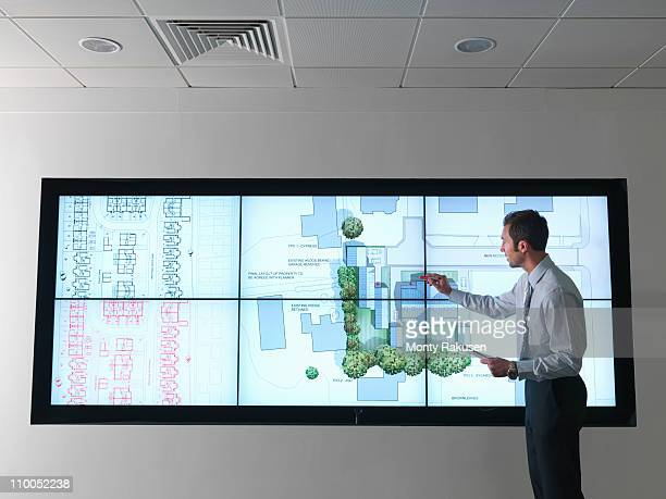 Architect works at plans on screen