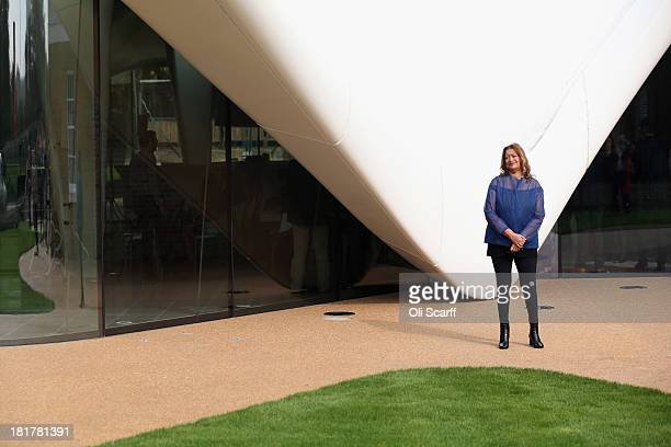 Architect Zaha Hadid poses for a photograph in front of the redeveloped Serpentine Sackler Gallery in Hyde Park on September 25 2013 in London...