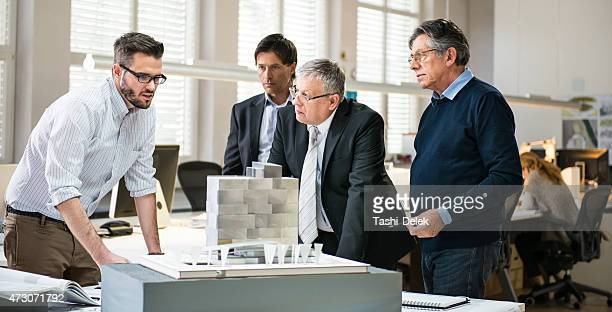 Architects and Custumer in Office