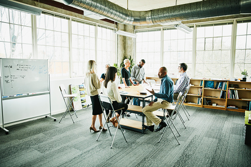 Architects and engineers in project planning meeting at conference table in design studio - gettyimageskorea