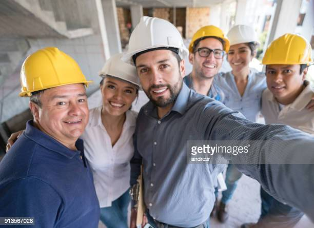 architects and engineers taking a selfie at a construction site - medium group of people stock pictures, royalty-free photos & images