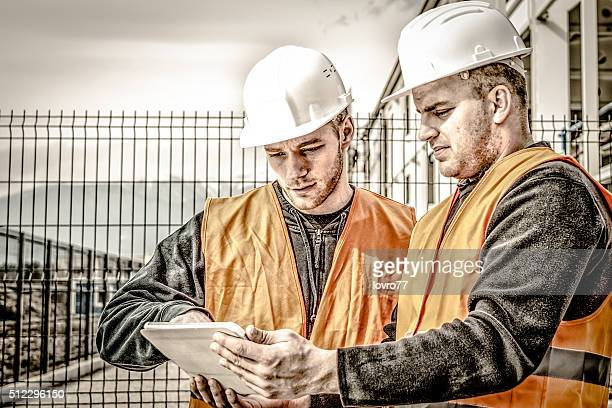 Architects at a building site with digital tablet