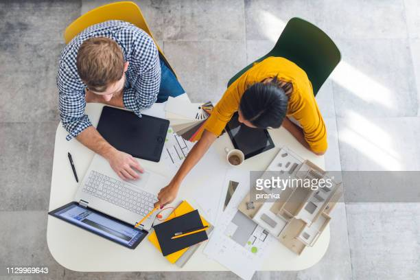 architects at work - yellow stock pictures, royalty-free photos & images