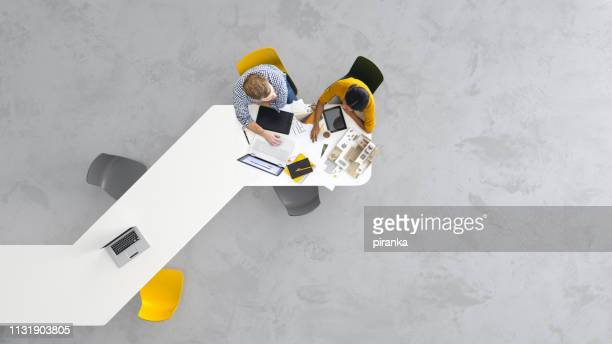 architects at work - overhead view stock pictures, royalty-free photos & images