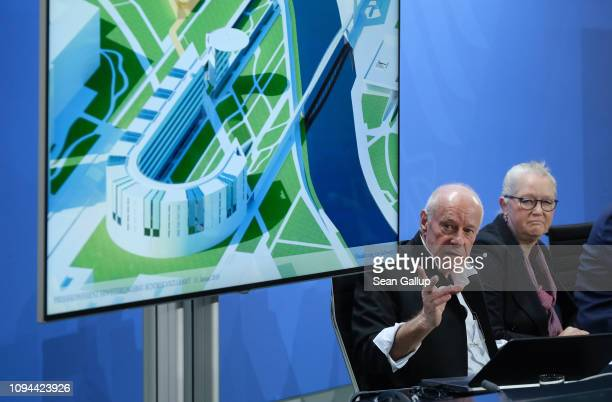 Architects Axel Schultes and Charlotte Frank speak to the media next to a rendition of their design of an extension to the Chancellery on January 15...