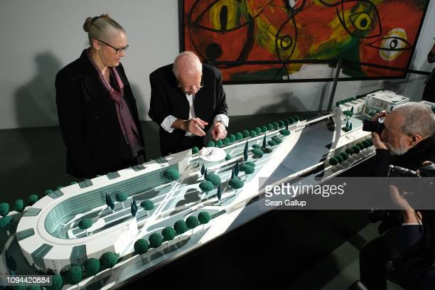 Architects Axel Schultes and Charlotte Frank stand over a model of their design of an extension to the Chancellery on January 15 2019 in Berlin...