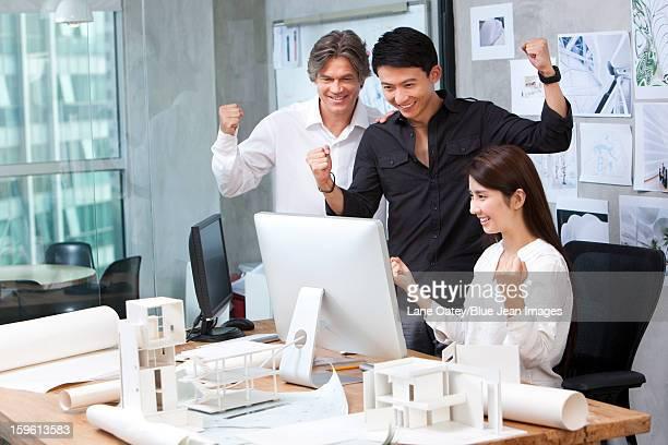 Architects celebrating in studio