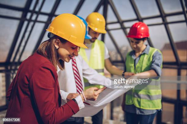 Architects checking the progress at construction site