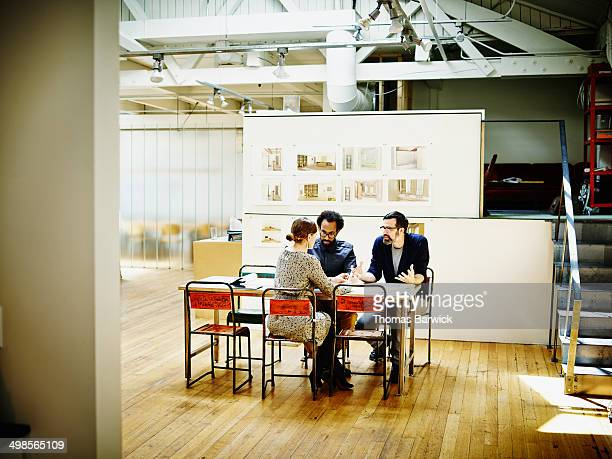 Architects discussing project in office