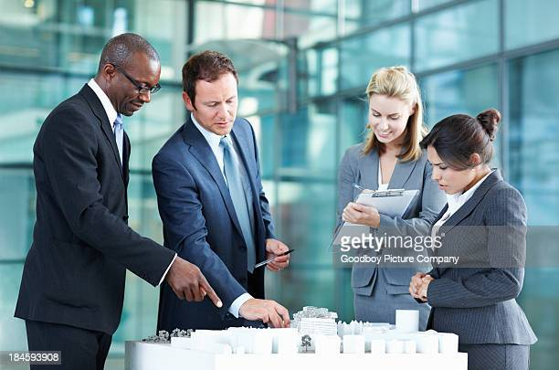 Architects discussing scale model