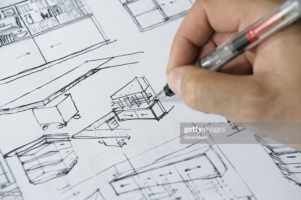 Architects hand sketching interior plans : Foto de stock