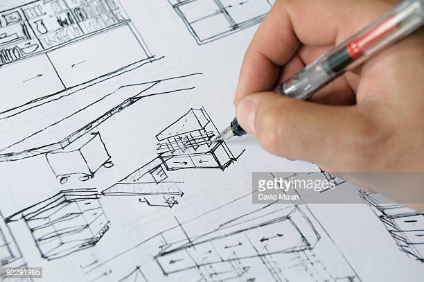 Architects hand sketching interior plans