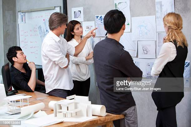 Architects having discussion in studio