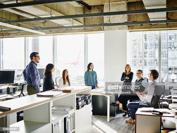 Architects having informal meeting in office