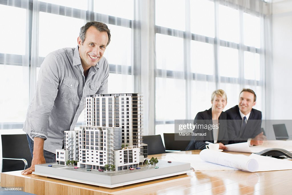 Architects in conference room with building model : Stock Photo