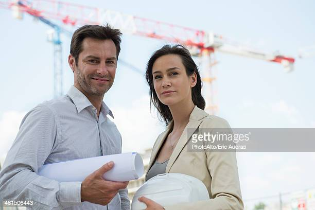 Architects in construction site, portrait