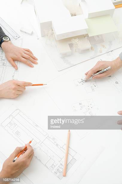 Architects meeting on a blueprint