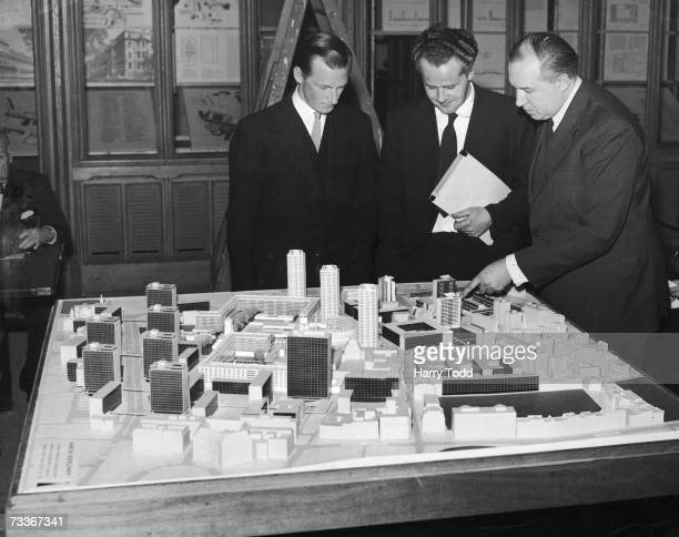 Architects Peter Chamberlin Geoffry Powell and Christof Bon at a press conference at the Guildhall London with their model of the proposed...