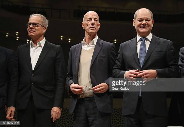 Architects Pierre De Meuron and Jacques Herzog and Hamburg City Mayor Olaf Scholz arrive for the press conference at the large hall of the...