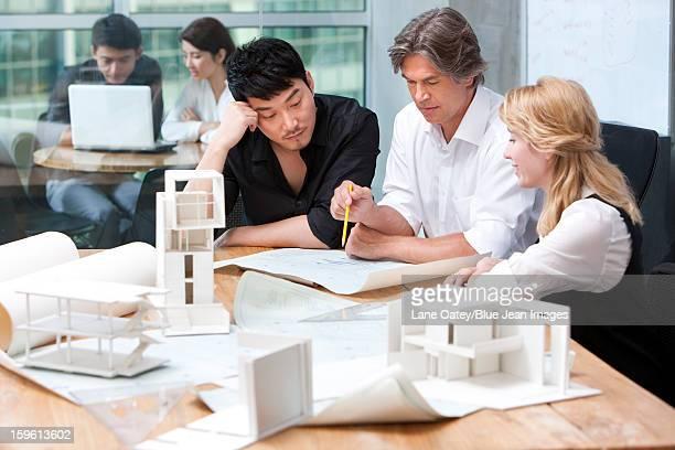 architects studying a blueprint - 建築模型 ストックフォトと画像
