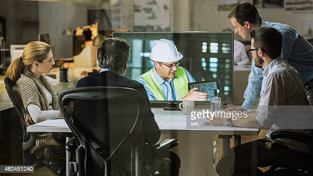 architects team having video conference - building contractor stock pictures, royalty-free photos & images
