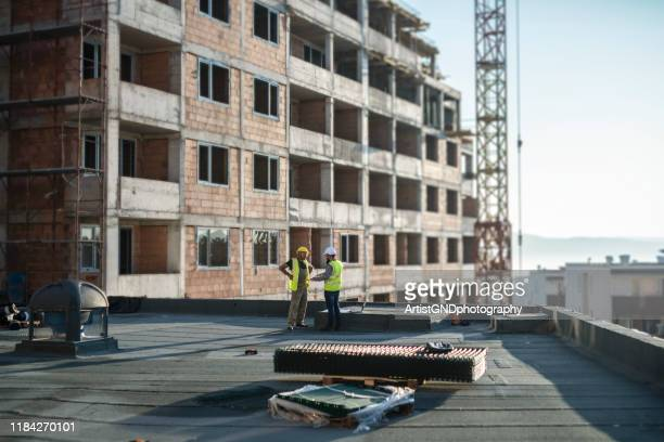 architects working on construction site. - copy space stock pictures, royalty-free photos & images
