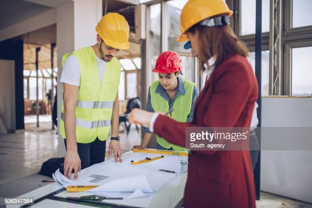Architects working on construction site