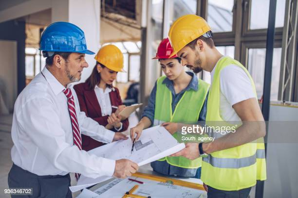Architects working together on construction site