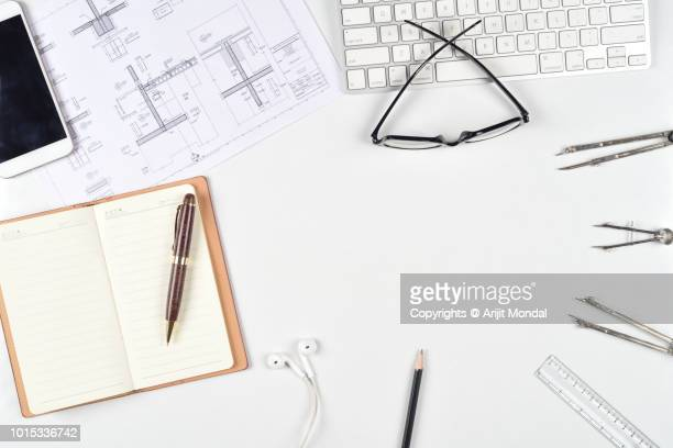 Architects Workplace with Architectural Project, Blueprints, Ruler, Mobile Phone, Laptop and Divider Compass Top View