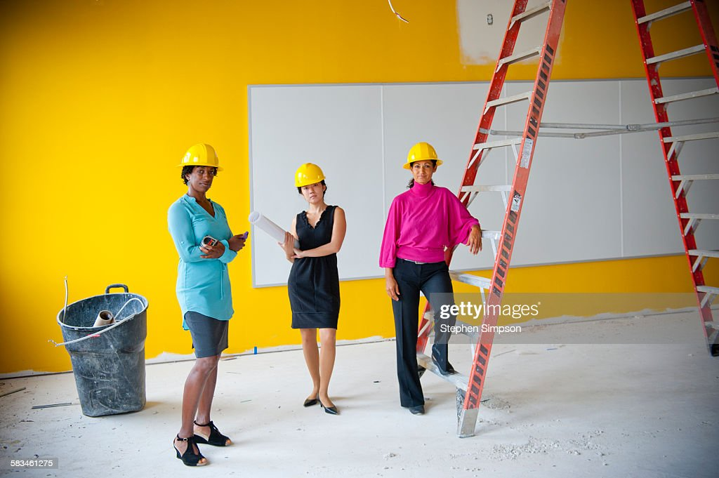 architects/contractors on school construction site : Stock Photo
