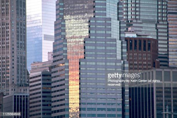 architectural background with sunset colors colors reflecting on glass and steel - financiën en economie stockfoto's en -beelden