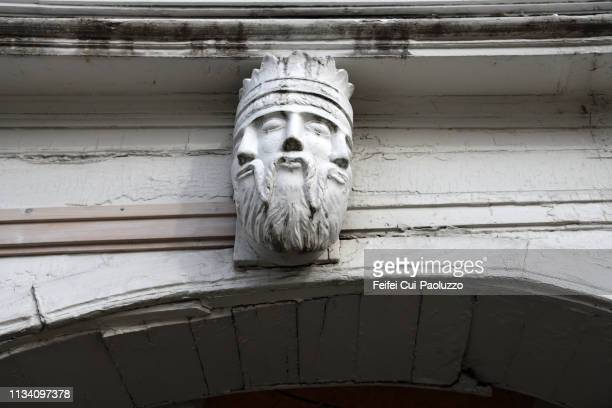 architectural detail of a head statue at at downtown bergen, western norway - hordaland county stock pictures, royalty-free photos & images