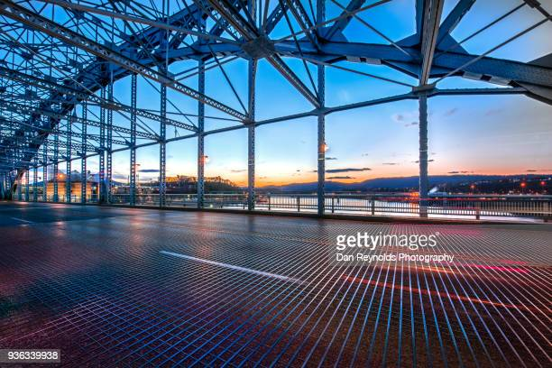 architectural detail of urban bridge at twilight - built structure stock pictures, royalty-free photos & images