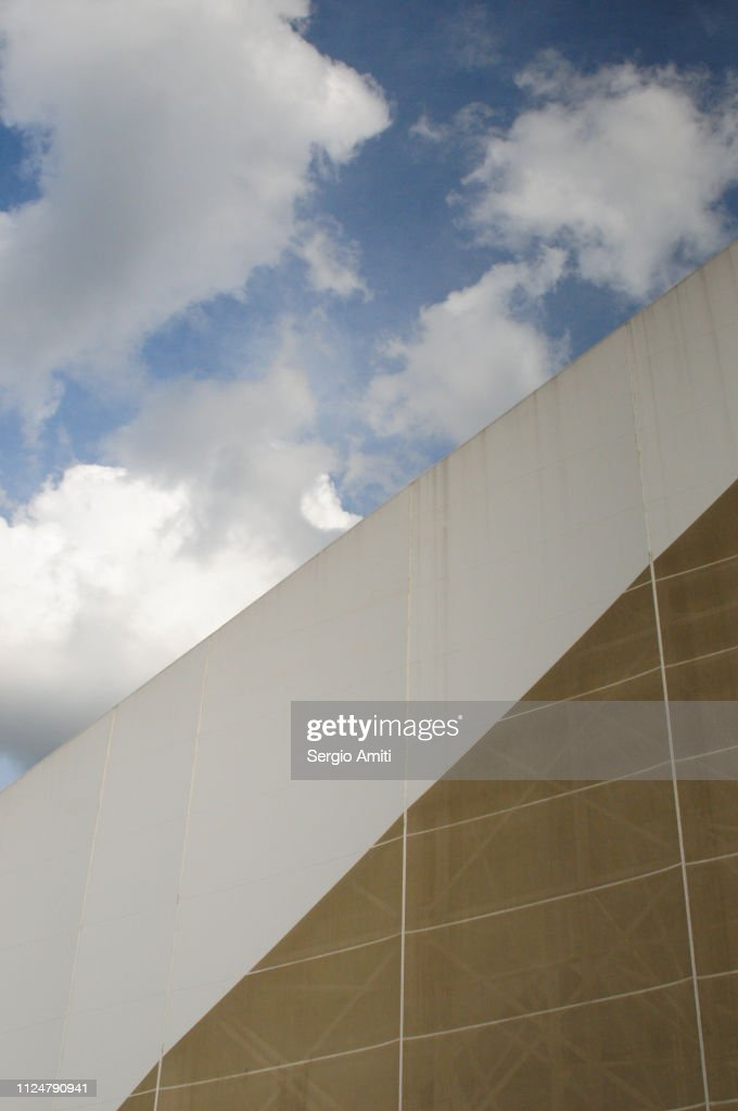 Architectural detail with blue sky with clouds : Stock Photo