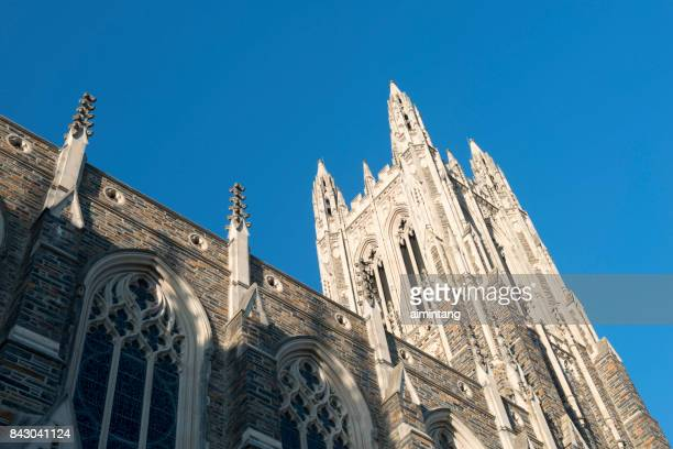 architectural details of duke university chapel - duke v north carolina stock photos and pictures