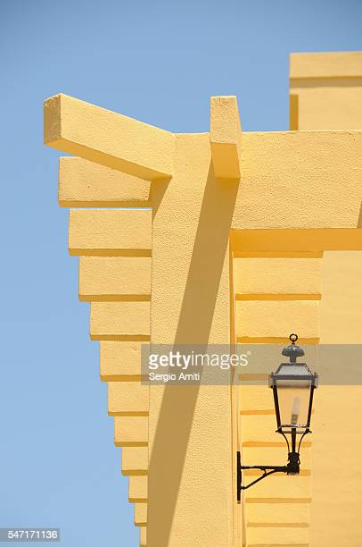 Architectural details of the roof a yellow house