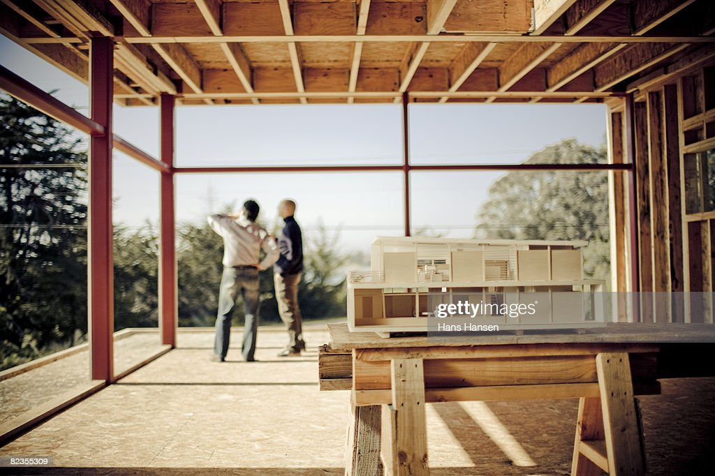 Architectural model on home construction site : Stockfoto