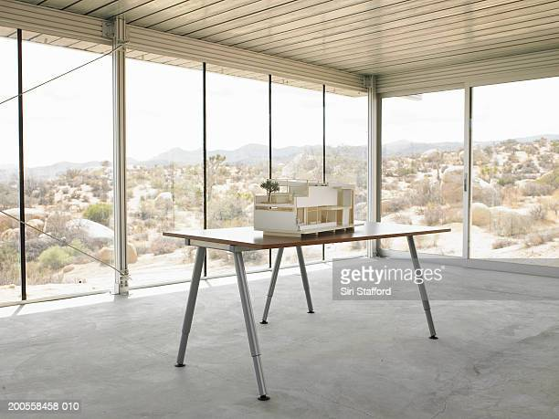 Architectural scale model on table in house under construction