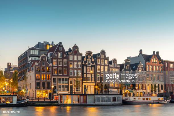 architecture and city lights in amsterdam, netherlands - amsterdam stock pictures, royalty-free photos & images