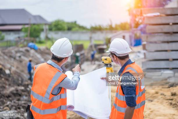 architecture and engineer construction working at construction site for survey - land stock pictures, royalty-free photos & images