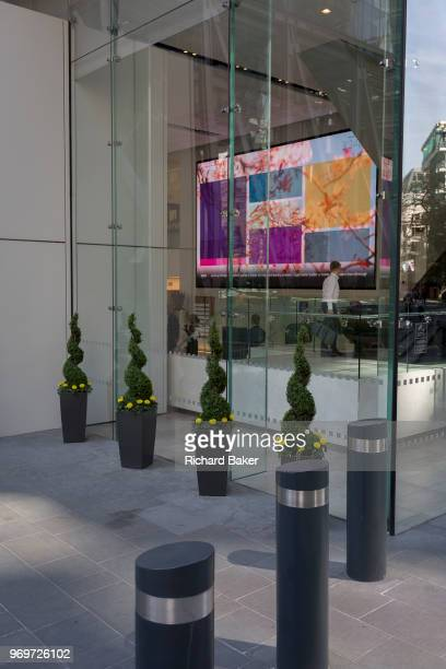 Architecture and info screens in the Aviva insurance building on the corner of Leadenhall and St Mary Axe in the City of London the capital's...