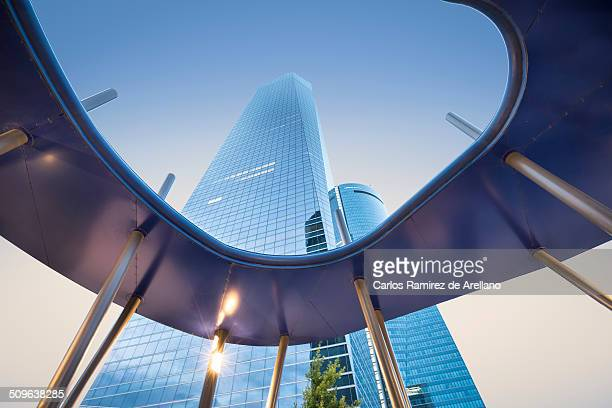 Architecture and modern buildings in Madrid in the financial area of the city View from the floor of the high towers under the blue sky