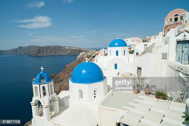 Architecture Blue cross on the church roof in Fira on Santorini island, Greece.
