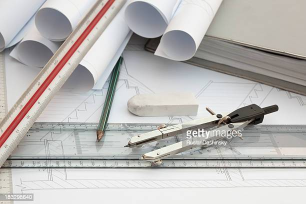 Architecture drawings, tools and work space.