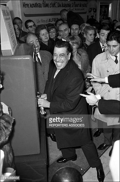 Archive Fernandel in the sixties in France Fernandel Jacques Brel Sacha Distel at the premiere of Hitchcock's Marnie in France on November 7 1964