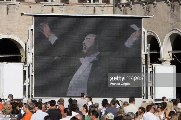 Archive footage of Pavarotti singing is shown on a giant screen in Piazza Grande prior to Luciano Pavarotti's funeral in Modena's Duomo on September...