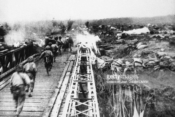 Archives: Dien Bien Phu Battle In Dien Bien Phu, Vietnam In May, 1954-Vietminh troops on Muong Thanh bridge. May 7, 1954.