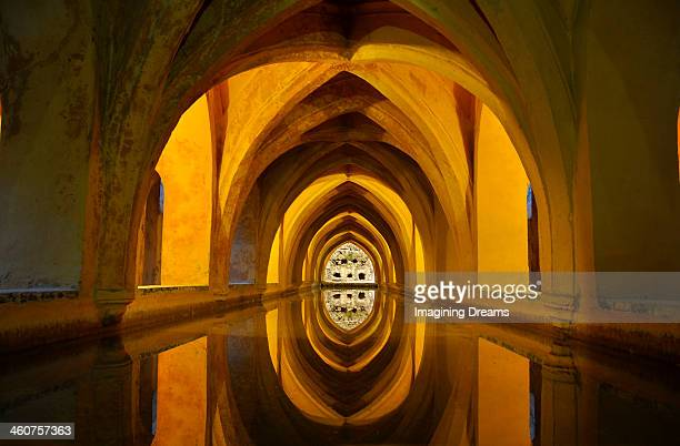 archs over water - seville stock pictures, royalty-free photos & images