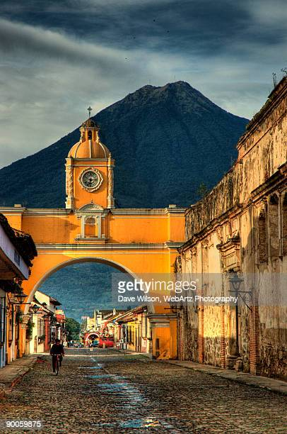 archway and volcano - guatemala stock pictures, royalty-free photos & images